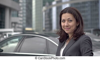 Successful woman in a business suit standing