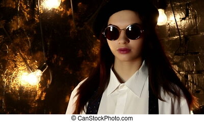 Portrait of a girl in sunglasses, beret and tshirt -...