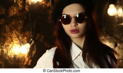 Portrait of a girl in sunglasses, beret and tshirt - Look of...