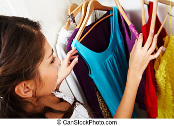Choosing what to wear - Image of pretty female looking...