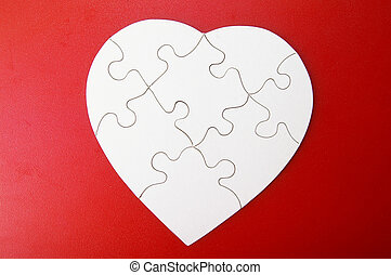 white jigsaw puzzle heart shape, on red