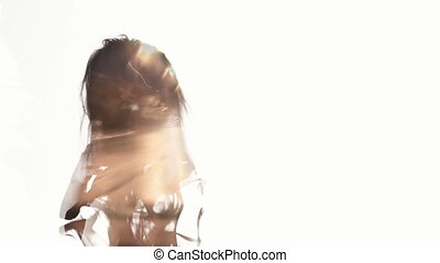 Double exposure. woman against the background lights of...