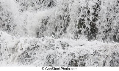 Spring waterfall background - Close-up spring waterfall with...