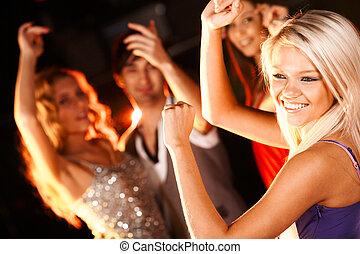 Dancer - Portrait of cheerful girl dancing at party with her...