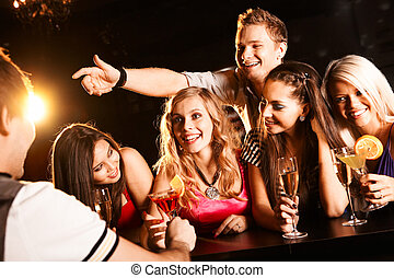 Chatting teens - Photo of joyful friends in the bar...