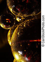 Disco balls - Vertical image of disco balls sparkling in...