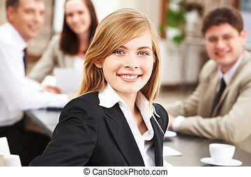 Young leader - Portrait of successful business lady looking...