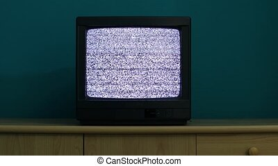 TV no signal - No reception just noise on an old TV in a dim...