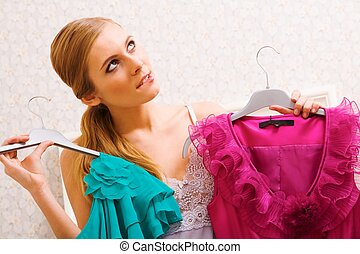 What to wear? - Image of pretty female thinking wat dress to...