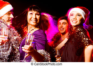 Enjoying party - Image of joyful friends having fun at disco...