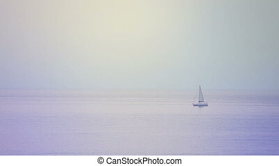 Sailboat in the evening in the sea
