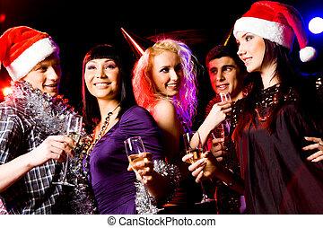 Christmas joy - Portrait of modern young people enjoying...