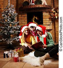 Family reading - Portrait of family spending Christmas...