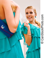 Smart lady - Image of pretty female in green dress looking...