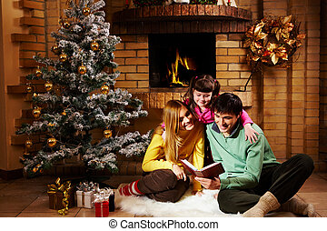Reading fairy tales - Portrait of cheerful family sitting on...