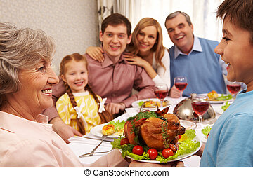 Tasty food - Portrait of happy grandmother holding tray with...