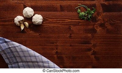Wooden table for cooking. Garlic on a wooden texture.