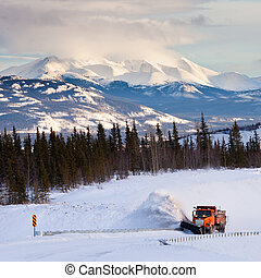 Snowplow clearing road in scenic Yukon T Canada - Snow plow...