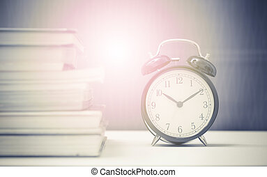 Vintage clock and stack of books time at 10 minute pass ten...