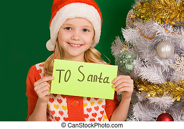 Christmas letter - Happy girl holding letter with note ?To...