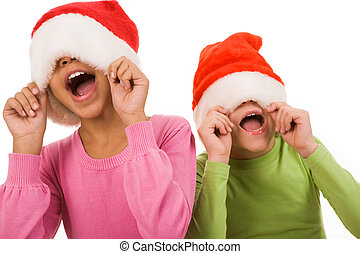 Joyful friends - Photo of happy friends in Santa caps having...