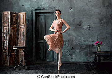 Young and incredibly beautiful ballerina is posing and...