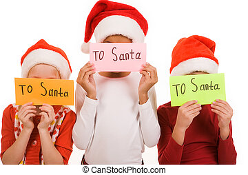 Letters to Santa - Happy children hiding their faces behind...
