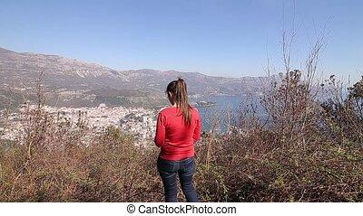 The girl tourist on the mountain. Budva, Montenegro,...