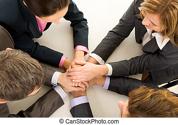 Partnership - Image of business people keeping hands on top...