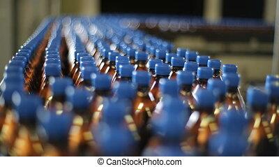 bottles on a conveyor belt factory - Conveyor of beer or...