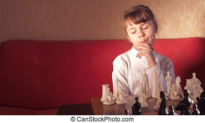 Child playing chess.