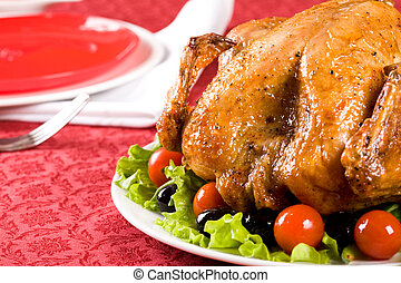 Christmas food - Image of roasted turkey surrounded by vegs...