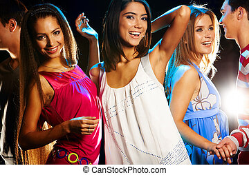 Dancing - Group of fashionable girls dancing energetically...