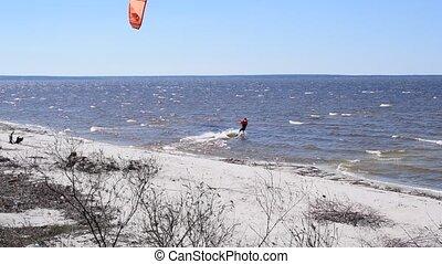 Kite surfing in spring. Shot on water storage lake of...