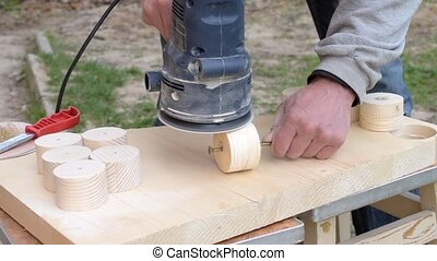 Sanding using a random orbital dual-action sander - Hands...
