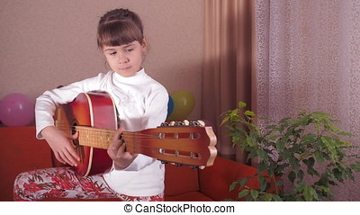 Child with guitar.