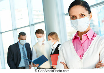 Healthcare - Confident leader in protective mask looking at...