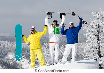 Joy - Portrait of three happy young men with snowboards...