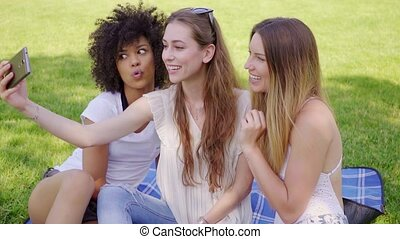 Women making faces and selfies - Group of pretty multiracial...