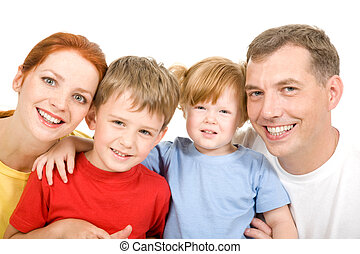 Cheerful family - Portrait of cheerful parents with their...
