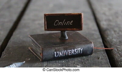 accredited online universities idea - Book - computer and...
