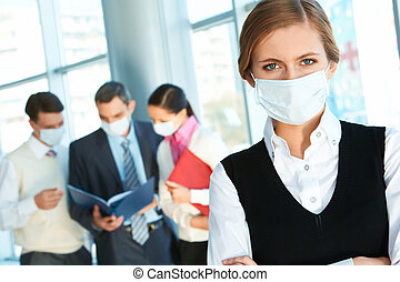 Danger of flu - Confident leader in protective mask looking...