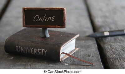 online education idea - Book - computer and inscription...