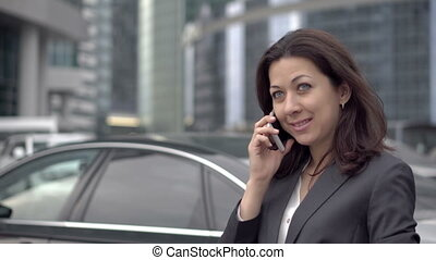 Independent woman in the suit talking mobile phone -...