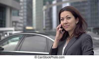 Successful businesswoman talks cell phone - A young...