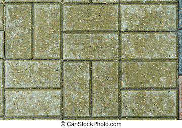 Green brick paving stones on a sidewalk. Abstract background...