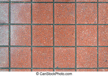 Red brick paving stones on a sidewalk. Abstract background...