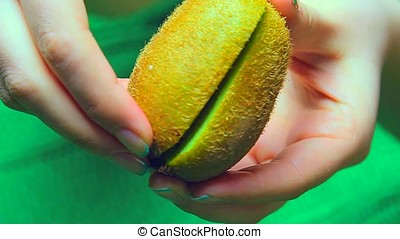 fresh kiwi fruit in hands