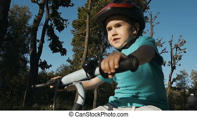 Boy Riding Bicycle - Little fourth year boy riding the...