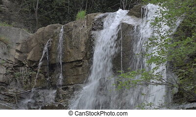 Waterfall in mountains of Georgia. Water flowing over rocks near Tbilisi